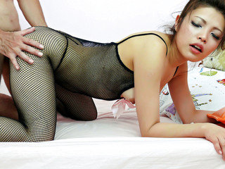 Yurika Gotou in a black fishnet body suit has her fine ass squeezed and pussy banged